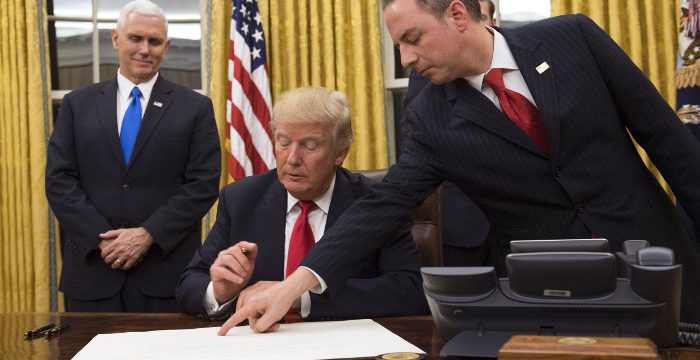 epa05736657 US President Donald J. Trump (C) prepares to sign a confirmation for Defense Secretary James Mattis as his Chief of Staff Reince Priebus (R) points to the order while Vice President Mike Pence (L) watches, after Trump was sworn in as the 45th President of the United States, at the White House in Washington, DC, USA, 20 January 2017. Trump won the 08 November 2016 election to become the next US President.  EPA/KEVIN DIETSCH / POOL