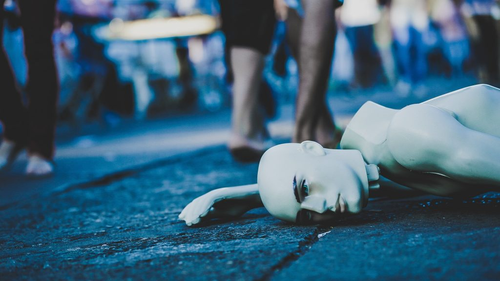 a mannequin lying on the road
