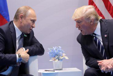 U.S. President Donald Trump speaks with Russian President Vladimir Putin during their bilateral meeting. REUTERS/Carlos Barria